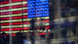 Aksionet rriten, por FMN paralajmëron SHBA-në